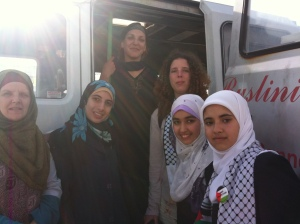 Three aunties and three Palestinian ladies with the Swansea minibus in Gaza.