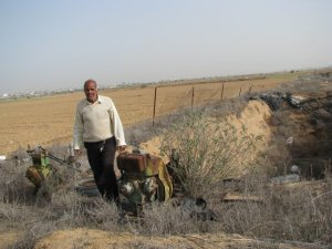 Farmer with rusty motors