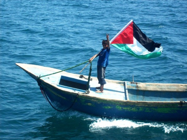 Ibrahim, son of a Palestinian fisherman, waits for the Freedom Flotilla in Gaza City harbour, 30 May 2010