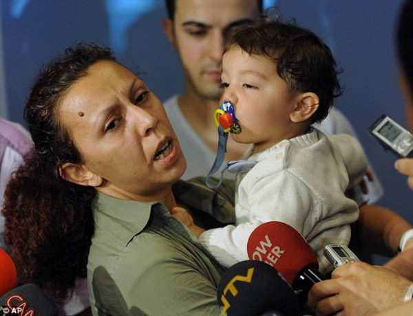 Nilufer Cetin, a Turkish aid volunteer, returns home with her one-year-old son after being one of the first to be deported by Israel.