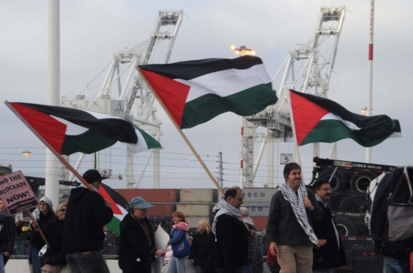 Dockers and activists stop the unloading of an Israeli ship in San Francisco, June 2010