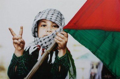 Palestinian child in kafiye holds flag and makes victory salute